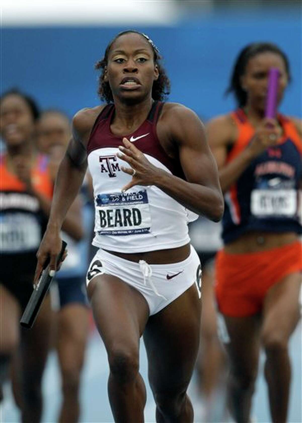 Texas A&M's Jessica Beard anchors her team in a 1600-meter relay prelim at the NCAA outdoor track and field championships, Friday, June 10, 2011, at Drake Stadium in Des Moines, Iowa. (AP Photo/Charlie Neibergall)