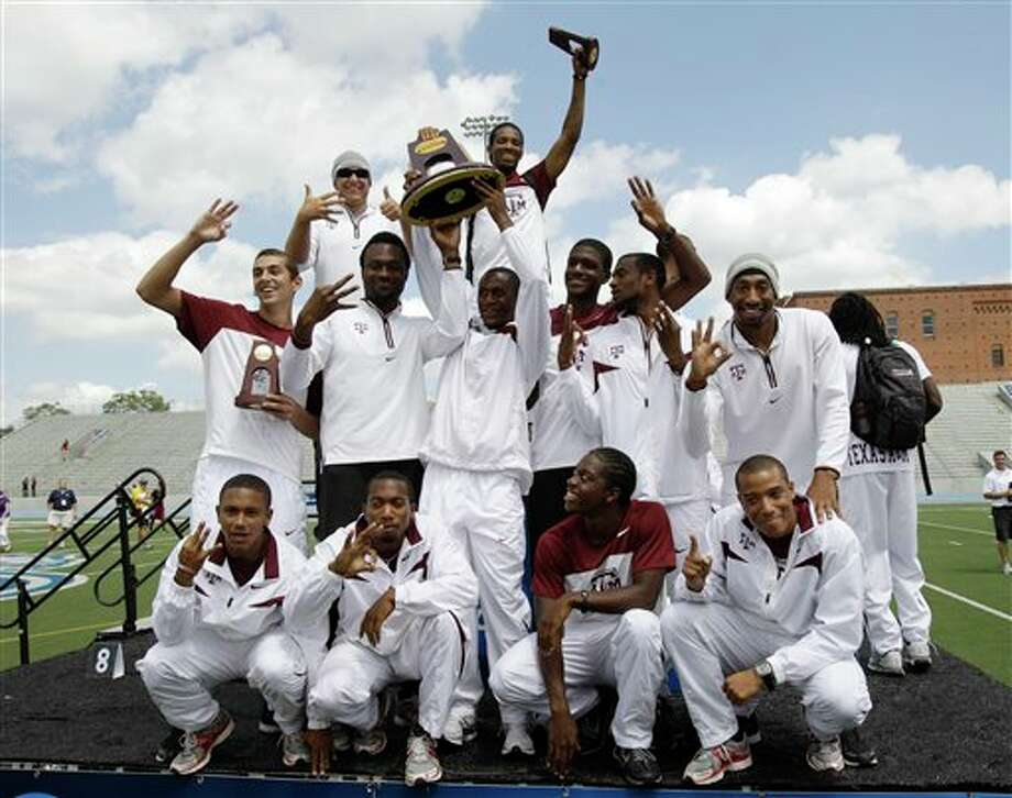 The Texas A&M men's team celebrates with the trophy after winning the team title at the NCAA college outdoor track and field championships, Saturday, June 11, 2011, at Drake Stadium in Des Moines, Iowa. (AP Photo/Charlie Neibergall) Photo: Associated Press