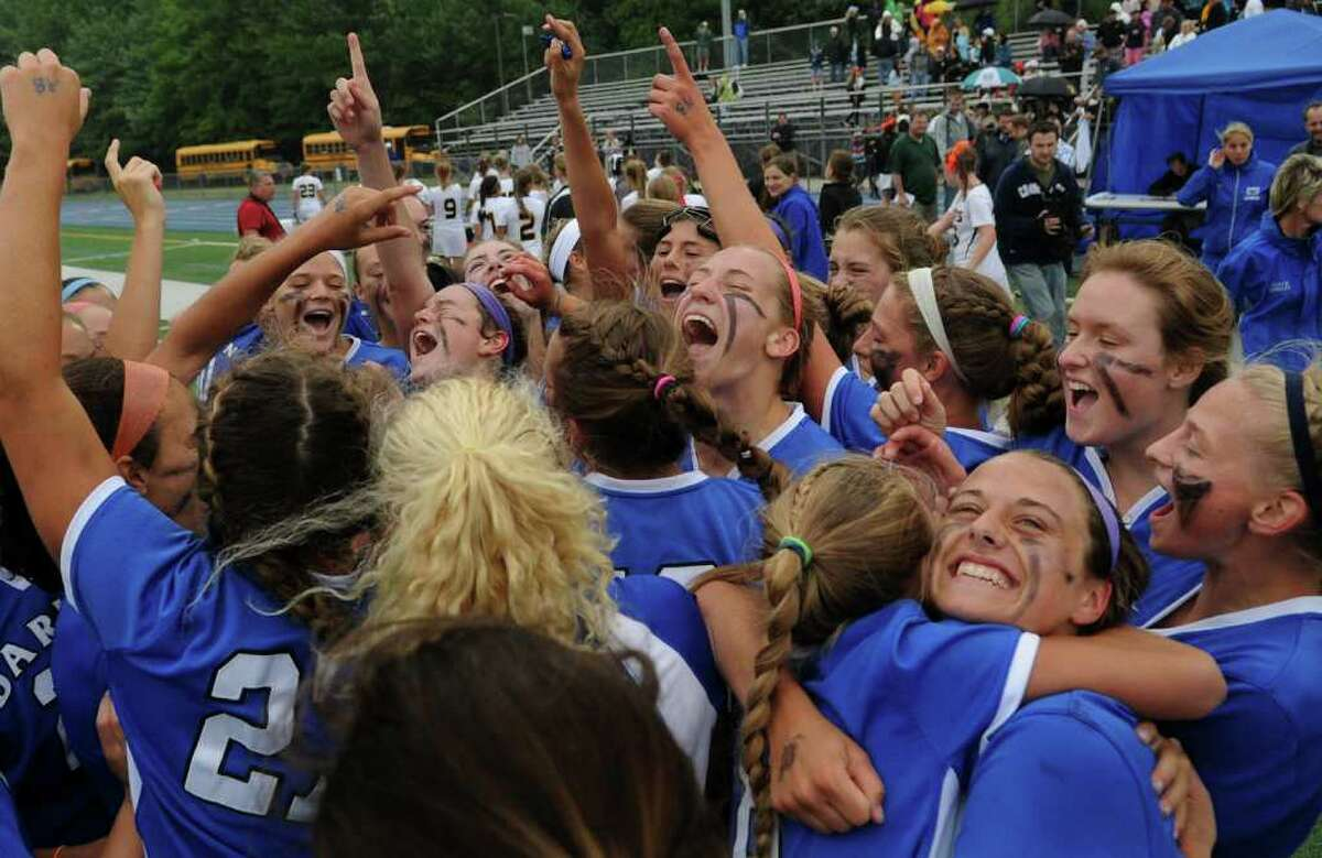 Darien celebrates its win over Daniel Hand, during state tournament girls lacrosse action in Stratford, Conn. on Saturday June 11, 2011.