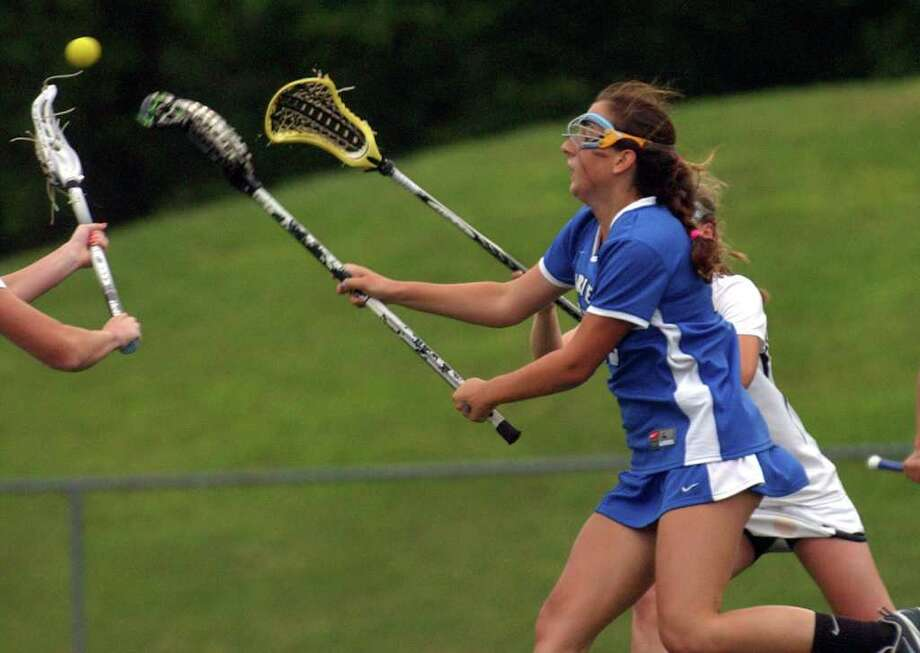 Darien's #18 Jena Fritz scores a goal, during state tournament girls lacrosse action against Daniel Hand in Stratford, Conn. on Saturday June 11, 2011. Photo: Christian Abraham / Connecticut Post