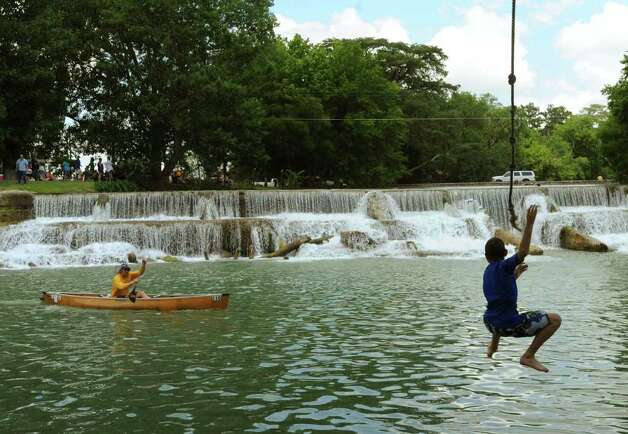 A child dives into the water by a competitor in the Texas Water Safari, in Staples, Texas, on Saturday, June 11, 2011. Photo: Billy Calzada/Express-News / gcalzada@express-news.net