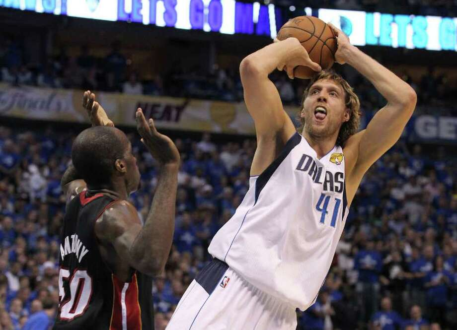 DALLAS, TX - JUNE 09:  Dirk Nowitzki #41 of the Dallas Mavericks attempts a shot against Joel Anthony #50 of the Miami Heat in Game Five of the 2011 NBA Finals at American Airlines Center on June 9, 2011 in Dallas, Texas.  NOTE TO USER: User expressly acknowledges and agrees that, by downloading and/or using this Photograph, user is consenting to the terms and conditions of the Getty Images License Agreement.  (Photo by Ronald Martinez/Getty Images) Photo: Ronald Martinez, Getty Images / 2011 Getty Images