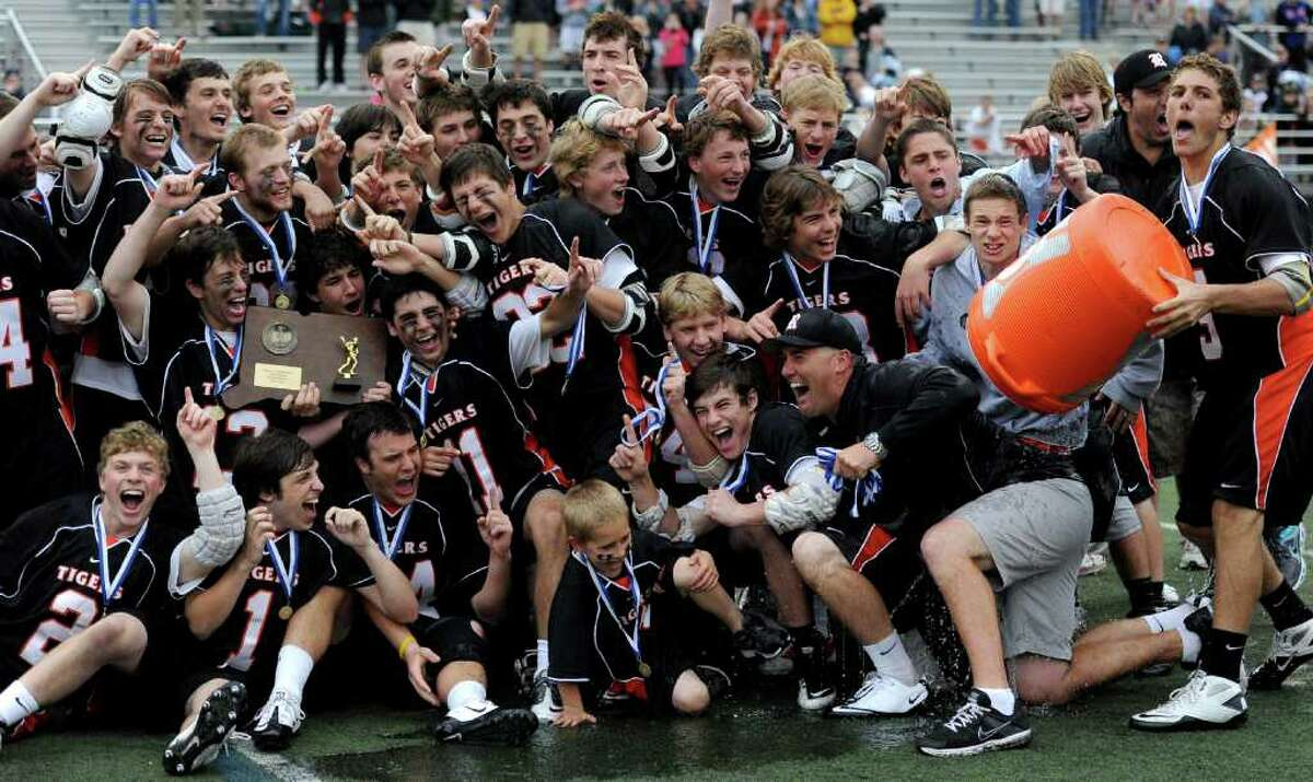 Ridgefield lacrosse players celebrate their win after Saturday's Division L final at Brien McMahon High School on June 11, 2011.