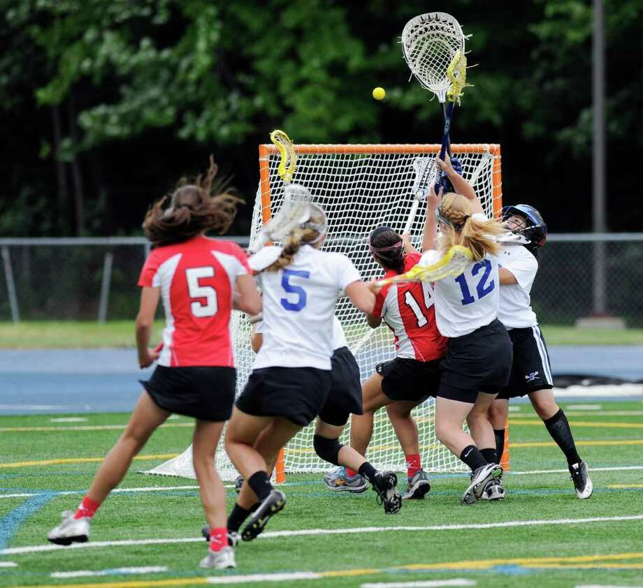 Brooke Swift of Greenwich High School # 14, mixes it up with Glastonbury goalie Marina Molnar, # 17, right, during the Class L girls lacrosse championship between Greenwich High School and Glastonbury High School at Bunnell High School, Stratford, Saturday, June 11, 2011.  Greenwich won the state title, 12-10.  Katrina Hodgkins # 12 and Nicole Geist # 5, both of Glastonbury close in, as does Emma Christie # 5 of Greenwich. Photo: Bob Luckey / Greenwich Time
