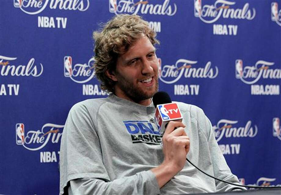 Dallas Mavericks' Dirk Nowitzki answers a question before a practice session for Game 6 of the NBA Finals against the Miami Heat, Saturday, June 11, 2011, in Miami. The Mavericks lead the basketball series 3-2. (AP Photo/Mark Humphrey) Photo: Associated Press