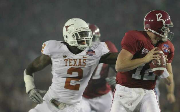 Texas defensive end Sergio Kindle (2) pressures Alabama quarterback Greg McElroy (12) during the first quarter of the Citi BCS National Championship football game at the Rose Bowl on Thursday, Jan. 7, 2010, in Pasadena, Calif. Photo: TOM REEL, Express-News / treel@express-news.net