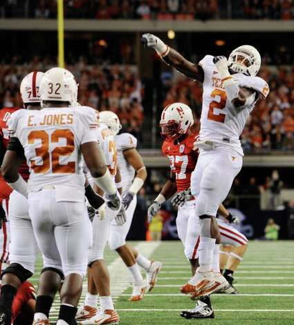 Texas defender Sergio Kindle celebrates during first-half action in the Big 12 championship game at Cowboys Stadium on Saturday, Dec. 5, 2009. BILLY CALZADA / gcalzada@express-news.net  Texas Longhorns Nebraska Cornhuskers / gcalzada@express-news.net