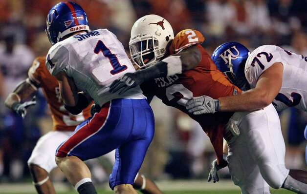 Sergio Kindle grabs Jake Sharp for a loss. Texas Longhorns play Kansas at Darrell K. Royal Memorial Stadium in Austin on Saturday,   November 21, 2009.   Tom Reel/Staff / treel@express-news.net