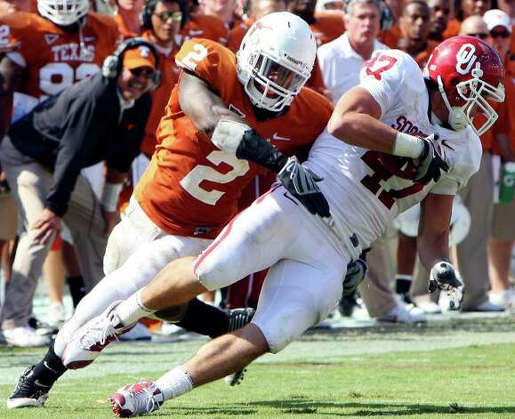 Texas Longhorns' Sergio Kindle tackles Oklahoma Sooners' Trent Ratterree during second half action of the Red River Rivalry Saturday Oct. 17, 2009 at the Cotton Bowl in Dallas, Tx. The Texas Longhorns won 16-13. Photo: EDWARD A. ORNELAS, Express-News / eaornelas@express-news.net