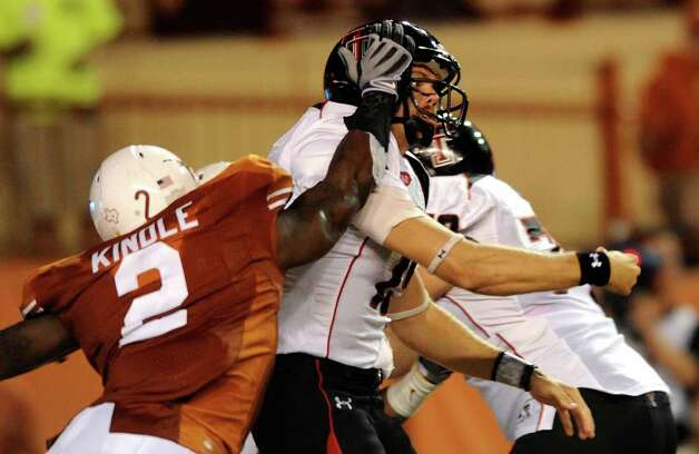 Texas Tech quarterback Taylor Potts is hammered by Texas linebacker Sergio Kindle during second-half Big 12 action in Austin on Saturday, Sept. 19, 2009. Texas won the game, 34-24. BILLY CALZADA / gcalzada@express-news.net / gcalzada@express-news.net