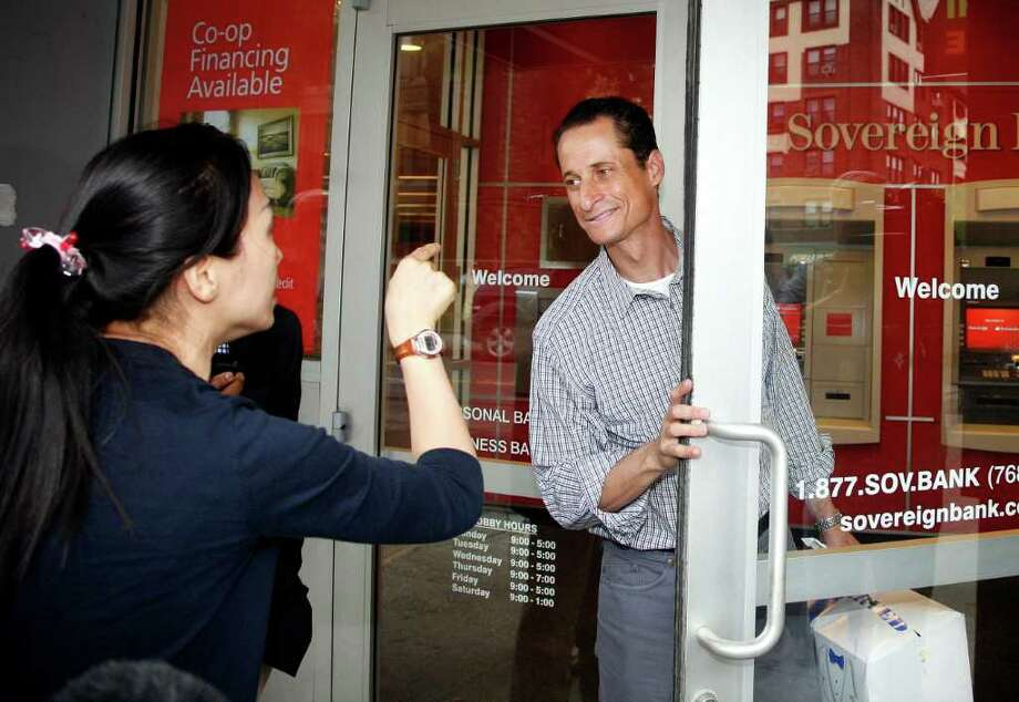 An unidentified woman tells Rep. Anthony Weiner, D-N.Y. she supports him,  as he enters a bank near his home in the Queens borough of New York, Saturday, June  11, 2011. The 46-year-old congressman acknowledged Friday that he had online contact with a 17-year-old girl from Delaware but said there was nothing inappropriate. (AP Photo/David Karp) Photo: DAVID KARP