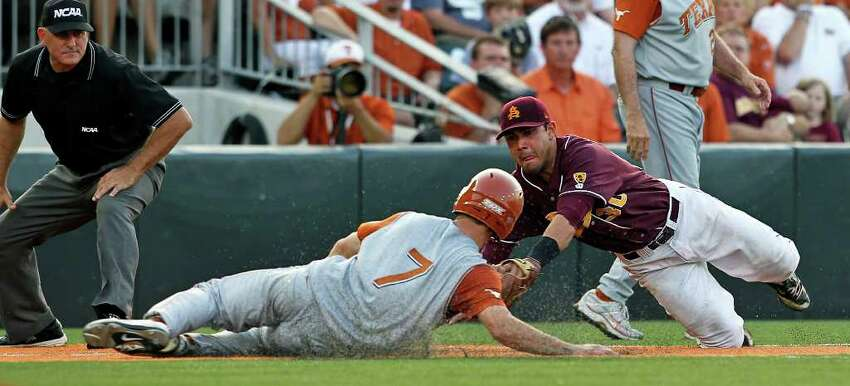 SPORTS Jordan Etier is out at third under the tag of Riccio Torrez in the seventh inning after trying to gain the base on a sacrifice fly as The University of Texas Longhorns play Arizona State in game 2 of their super regional playoff series at Disch-Falk Field in Austin on June 11, 2011. Tom Reel/Staff