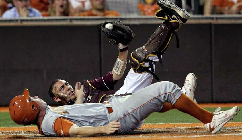Longhorns runner Tant Shepherd looks up to see the Arizona catcher Austin Barnes still holding the ball on a put out at home as the Texas Longhorns play Arizona State in game 2 of their super regional playoff series at Disch-Falk Field in Austin on June 11, 2011. Tom Reel/Staff