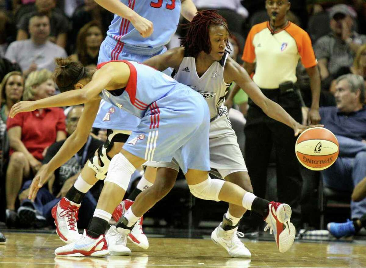 Silver Stars guard Danielle Robinson steals the ball from Atlanta guard Lindsey Harding as the Silver Stars take on the Dream on June 11, 2011, at AT&T Center. ANDREW BUCKLEY / abuckley@express-news.net