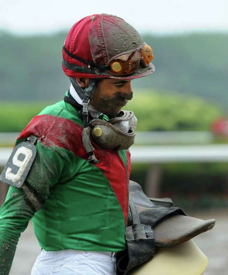 Jockey John Velazquez shows the dejection after losing his stirrup and a lot of ground to the rest of the field to finish back in the pack with Kentucky Derby winner Animal Kingdom in the 143rd running of the Belmont Stakes at  Belmont Park in Elmont, N.Y. June 11, 2011.    (Skip Dickstein / Times Union) Photo: SKIP DICKSTEIN