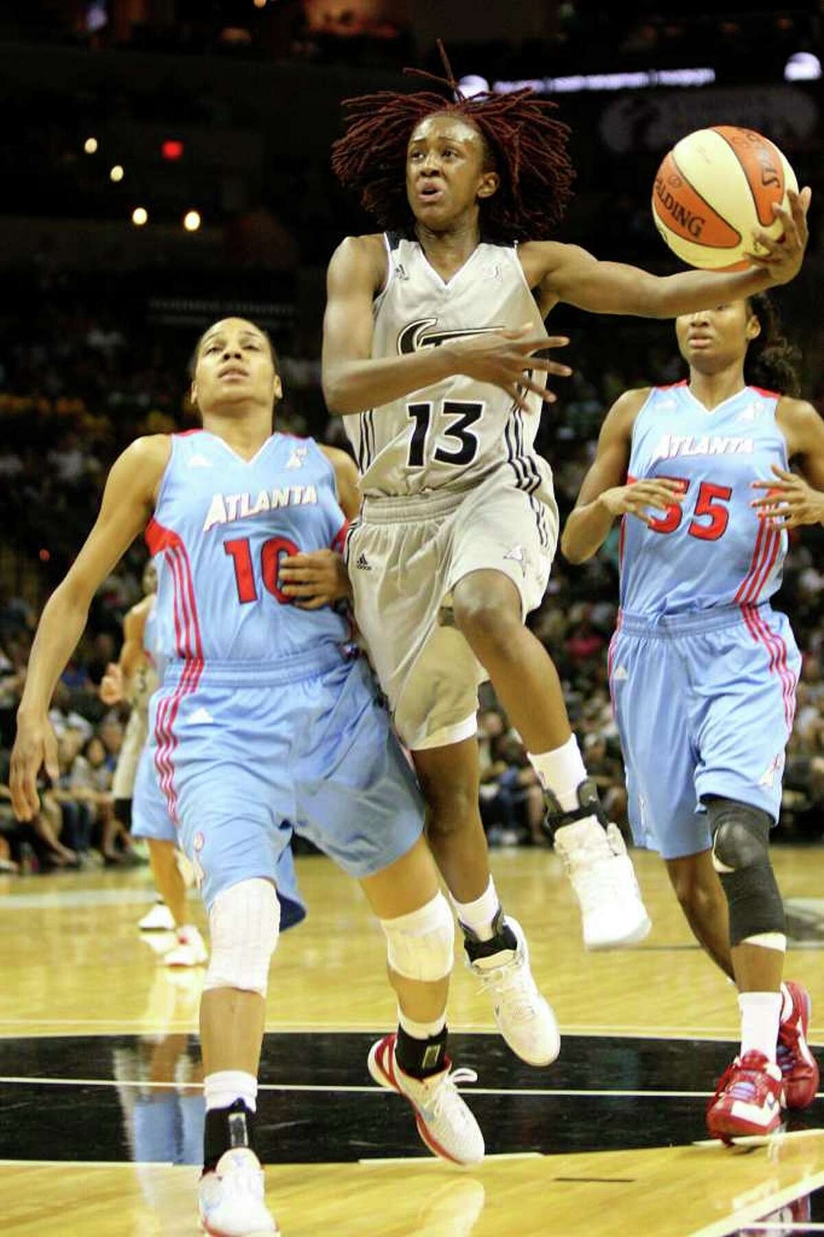 Silver Stars guard Danielle Robinson attempts a layup during the Silver Stars 86-74 win over the Atlanta Dream on June 11, 2011, at AT&T Center. ANDREW BUCKLEY / abuckley@express-news.net