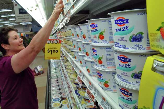 Donna Esposito of Lansingburgh purchases FAGE Greek yogurt at the Hannaford store in Latham Farms on Thursday June 9, 2011 in Latham, NY. She said the FAGE yogurt is delicious. ( Philip Kamrass / Times Union) Photo: Philip Kamrass