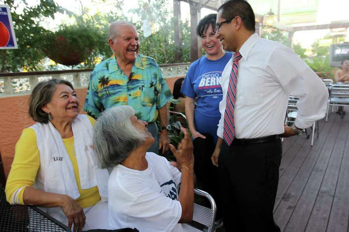 From left, Mary Esther Bernal, former senator Joe Bernal, poll volunteer Emma Gregory (front), and campaign fundraiser Rose L. Garcia, congratulate Diego Bernal as he arrives at his runoff victory party for the District 1 City Council seat at Los Barrios, June 11, 2011. (Jennifer Whitney/ Special to the San Antonio Express-News)