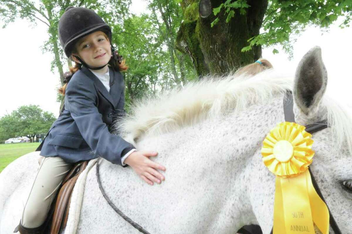 Nancy Perkins, 8, pets her pony Parker at the Greenwich Riding and Trails Association's 90th annual Greenwich Horse Show at the estate of Mr. and Mrs. Gerrish Milliken on Pierson Drive, in Greenwich, Sunday, June 12, 2011.