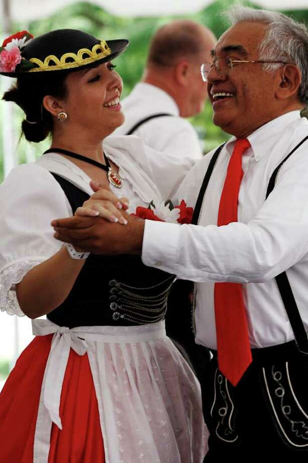 Jessica Dye and Richard Sierra, of De Deutsche Volkstanzverein of San Antonio, dance during the 40th annual Texas Folklife Festival at the Institute of Texan Cultures on Sunday, June 12, 2011. Photo: Jerry Lara/Express-News / SAN ANTONIO EXPRESS-NEWS