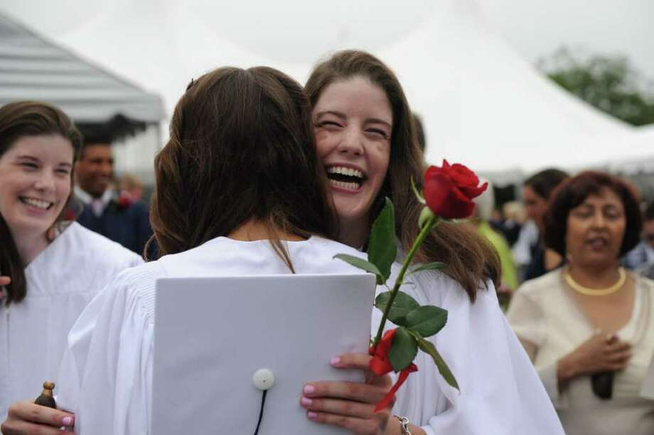 Emily Wilson, facing, hugs fellow graduate Katherine Gimpel after the King Low Heywood Thomas Class of 2011 graduation ceremony in Stamford, Conn., June 12, 2011. Retired New York Life Insurance Company President Fred Sievert gave the commencement address. Photo: Keelin Daly / Stamford Advocate