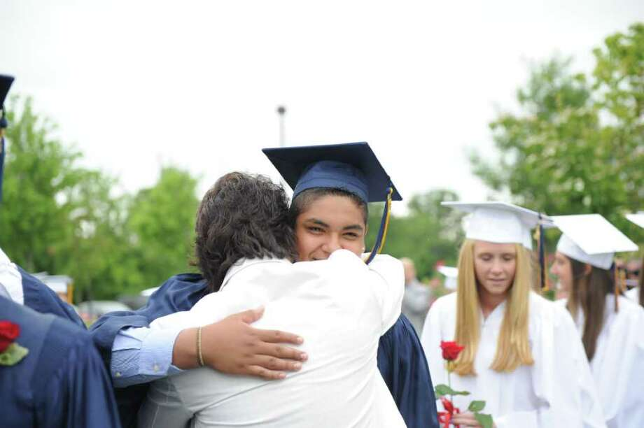 Michael Valasco gets a hug from his dad, George, as he heads into the King Low Heywood Thomas Class of 2011 graduation ceremony in Stamford, Conn., June 12, 2011. Retired New York Life Insurance Company President Fred Sievert gave the commencement address. Photo: Keelin Daly / Stamford Advocate