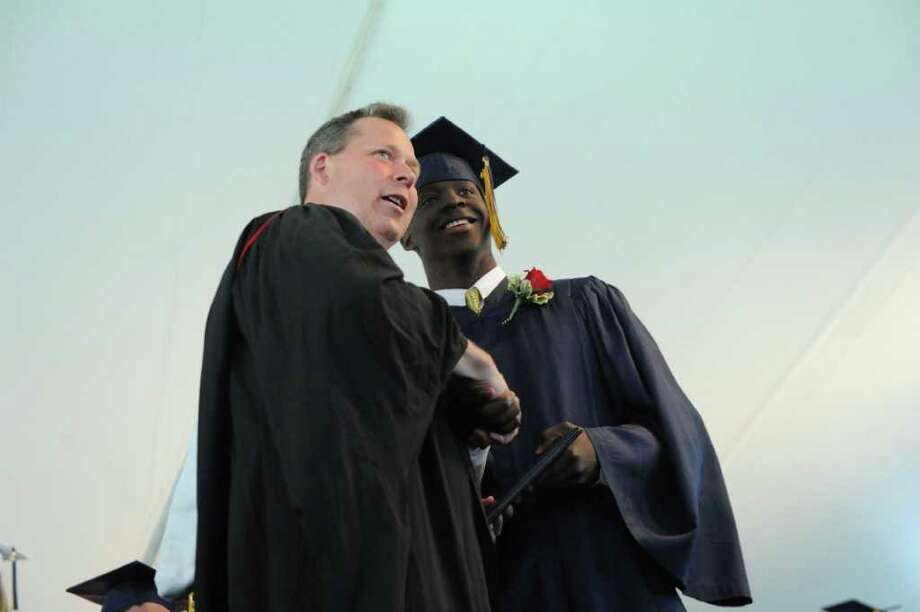 Tre Dairon Tipton receives his diploma during the King Low Heywood Thomas Class of 2011 graduation ceremony in Stamford, Conn., June 12, 2011. Retired New York Life Insurance Company President Fred Sievert gave the commencement address. Photo: Keelin Daly / Stamford Advocate