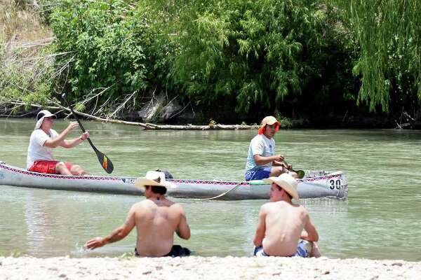 Ralph Castillo (left) and Tomas Villarreal approach the Gonzales Hwy 183 bridge checkpoint on the Guadalupe River on Sunday, June 12, 2011, during the Texas Water Safari in Gonzales. The race is 260 miles from San Marcos to Seadrift.