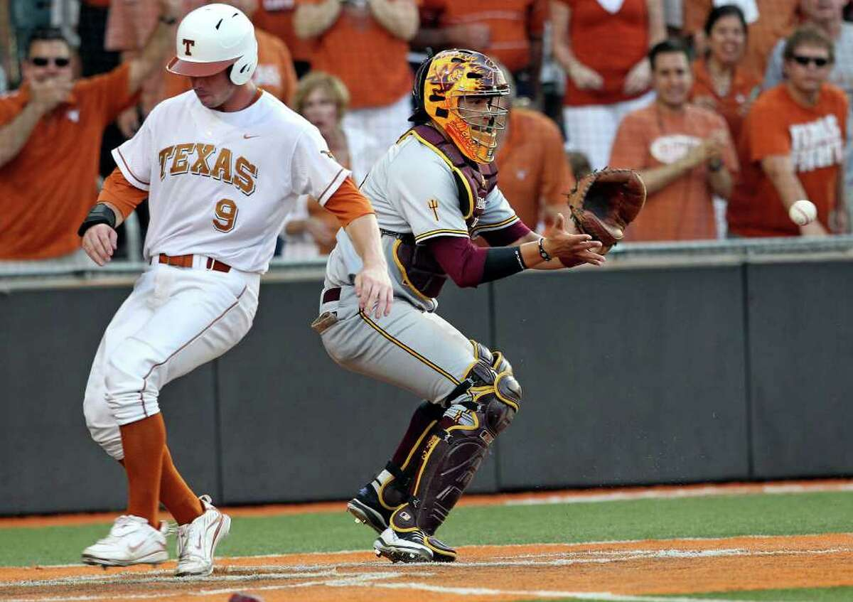 Longhorns runner Tant Sheperd scores in the sixth inning as the Texas Longhorns play Arizona State in game 3 of their super regional playoff series at Disch-Falk Field in Austin on June 12, 2011. Tom Reel/Staff