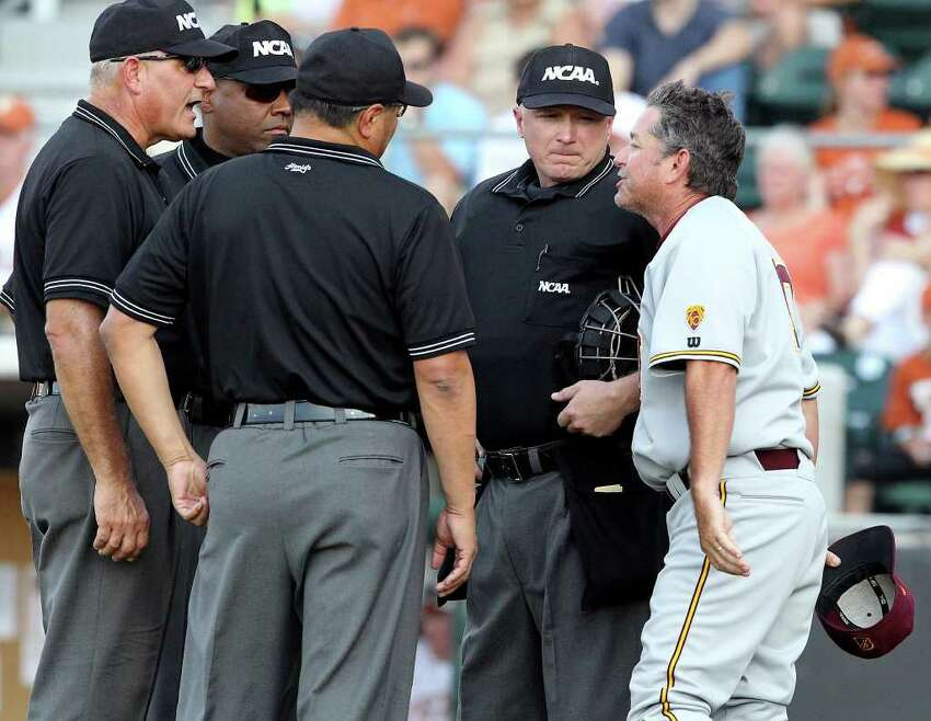 Arizona State coach Tim Esmay argues the call which brought his runner back from third in the early innings as the Texas Longhorns play Arizona State in game 3 of their super regional playoff series at Disch-Falk Field in Austin on June 12, 2011. Tom Reel/Staff