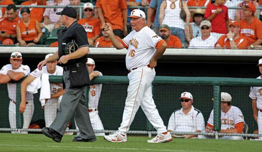 Longhorns coach Augie Garrido gets the umpires to talk about the controversial play which would have advanced an Arizona State runner to third in the early innings as the Texas Longhorns play Arizona State in game 3 of their super regional playoff series at Disch-Falk Field in Austin on June 12, 2011. Tom Reel/Staff