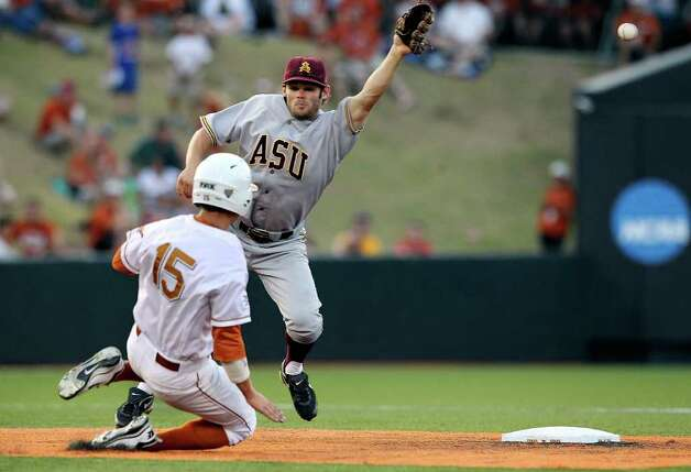 Longhorns runner Mark Payton gets to second safely under a wild throw to Zach MacPhee in the sixth inning as the Texas Longhorns play Arizona State in game 3 of their super regional playoff series at Disch-Falk Field in Austin on June 12, 2011.   Payton moved to third then scored.  Tom Reel/Staff Photo: TOM REEL, Express-News / © 2011 San Antonio Express-News