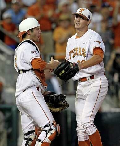 Longhorns closer Corey Knebel is congratulated by catcher Jacob Felts as the Texas Longhorns play Arizona State in game 3 of their super regional playoff series at Disch-Falk Field in Austin on June 12, 2011.    Tom Reel/Staff Photo: TOM REEL, Express-News / © 2011 San Antonio Express-News