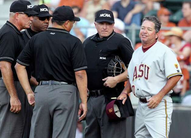 Arizona coach Tim Esmay argues the controversial call which brought his runner back from third in the early innings as the Texas Longhorns play Arizona State in game 3 of their super regional playoff series at Disch-Falk Field in Austin on June 12, 2011.    Tom Reel/Staff Photo: TOM REEL, Express-News / © 2011 San Antonio Express-News