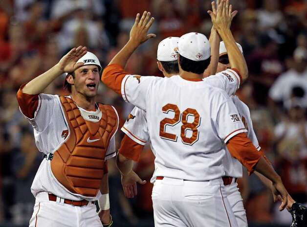 Longhorns catcher Jacob Felts high fives his teammates after a 4-2 win as the Texas Longhorns play Arizona State in game 3 of their super regional playoff series at Disch-Falk Field in Austin on June 12, 2011.    Tom Reel/Staff Photo: TOM REEL, Express-News / © 2011 San Antonio Express-News