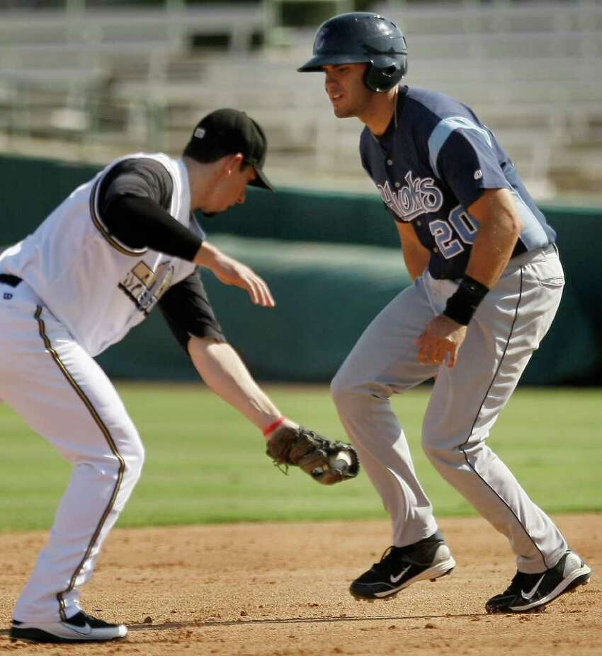 Corpus Christi Hooks' J.D. Martinez, right, is forced out at second by San Antonio MIssions' Anthony Contreras during a Texas league baseball game, Sunday, June 12, 2011, in San Antonio. San Antonio won 6-4.