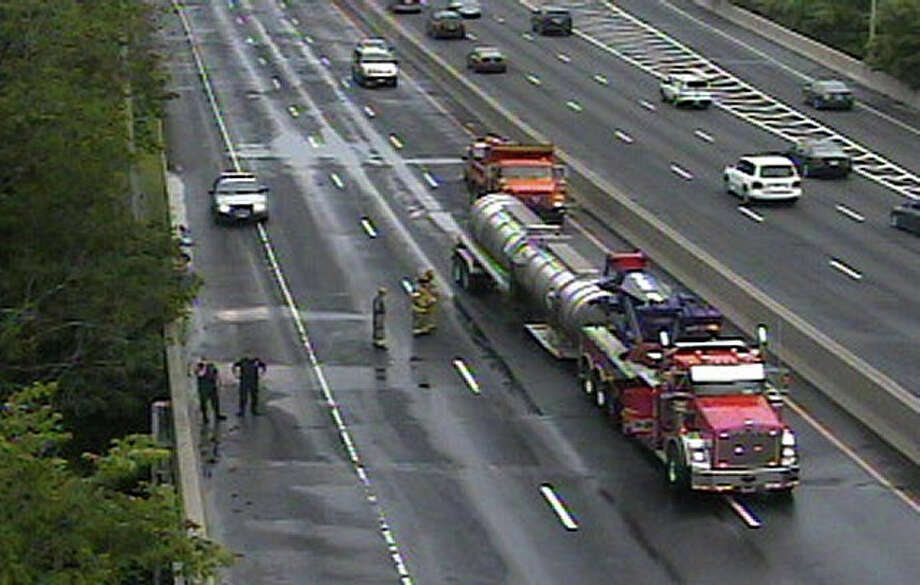 This Department of Transportation traffic camera via WTNH shows a disabled tanker between exits 8 and 9 on I-95 northbound in Stamford. The tanker became unhitched, causing a methanol spill and forcing officials to close all northbound roadways for several hours on Monday morning, June 13, 2011. Photo: Contributed Photo / Connecticut Post Contributed