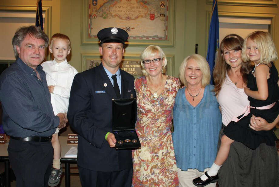 Newly sworn-in Fairfield Fire Lieut. Justin Greenhaw, third from left, is joined by his family at the recent Fire Commission promotion ceremony. They are, from left: his father James holding Justin's son Mitchell, his wife Tara, his mother Susan and his sister Kelli holding his daughter Madeline. Photo: Contributed Photo / Fairfield Citizen contributed