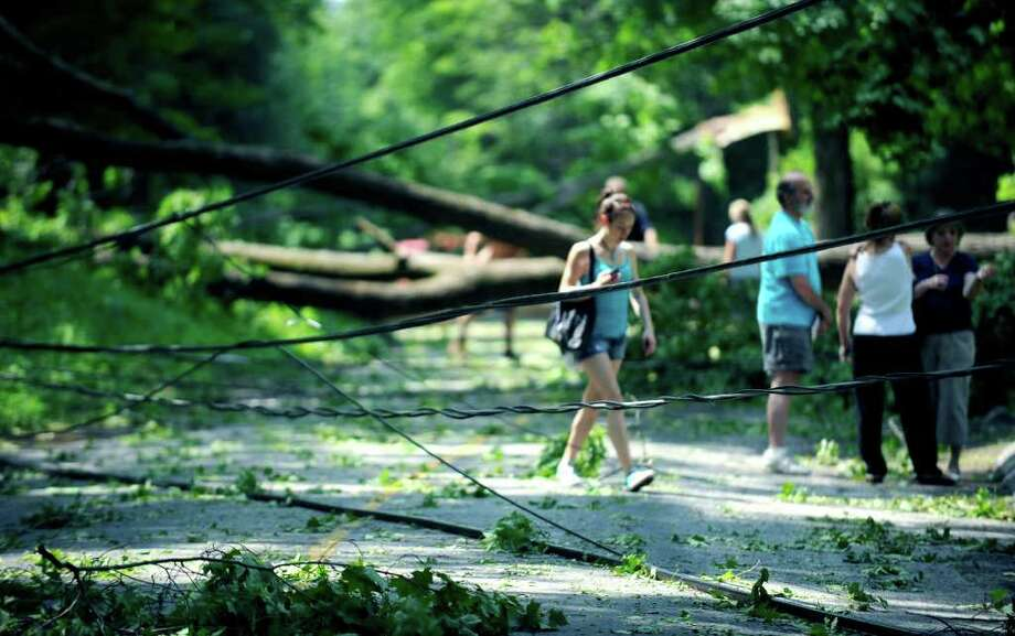 SPECTRUM/Wires and trees were down all over Carmen Hill Road in New Milford and Brookfield on June 10, 2011 after the previous day's thunderstorms. Photo: Carol Kaliff / The News-Times