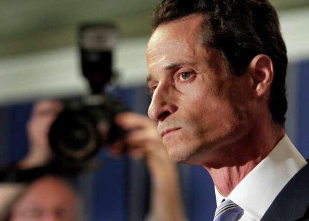 "U.S. Rep. Anthony Weiner, D-N.Y., addresses a news conference in New York,  Monday, June 6, 2011. After days of denials, a choked-up New York Democratic Rep. Anthony Weiner confessed Monday that he tweeted a bulging-underpants photo of himself to a young woman and admitted to ""inappropriate"" exchanges with six women before and after getting married. (AP Photo/Richard Drew) Photo: Richard Drew, STF / AP"