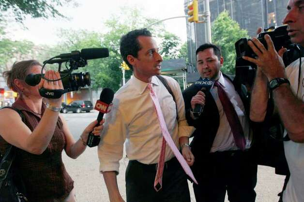 Rep. Anthony Weiner, D-N.Y., is surrounded by reporters as he arrives at his house in the Queens borough of New York,  Thursday, June 9, 2011. Weiner admitted four days ago that he had Tweeted sexually charged messages and photos to at least six women and lied about it.  (AP Photo/Mary Altaffer) Photo: Mary Altaffer, STF / AP
