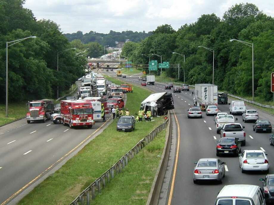 Truck flips over, two ejected, on I-95 in Norwalk