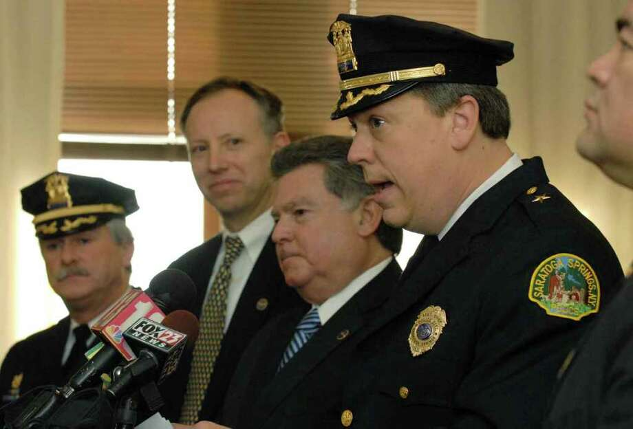 Saratoga Springs Police Chief Christopher Cole, right, speaks during a press conference at City Hall in Saratoga Springs in December 2009. From left are former Police Chief Edward Moore, Saratoga County District Attorney James Murphy and Commissioner of Public Safety Richard Wirth. (Michael P. Farrell/Times Union archive) Photo: MICHAEL P. FARRELL / 00006707A