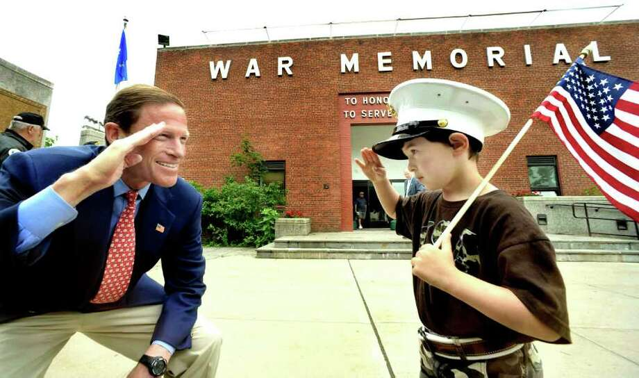 U.S. Sen. Richard Blumenthal trades salutes with Steven Johnston, 7, of New Fairfield, after a Flag Day event at the Danbury War Memorial building in Rogers Park, Sunday, June 12, 2011. Photo: Michael Duffy / The News-Times