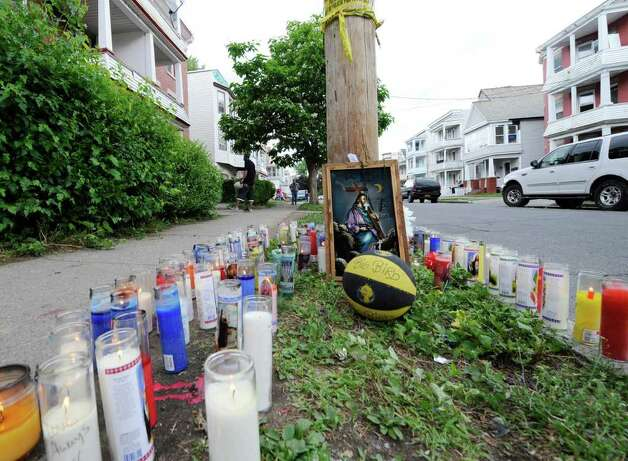 A makeshift memorial for Eddie Stanley was erected on Bridge St. in Schenectady, Monday June 13, 2011, near where Stanley was shot last Sunday.  (Skip Dickstein/ Times Union) Photo: Skip Dickstein