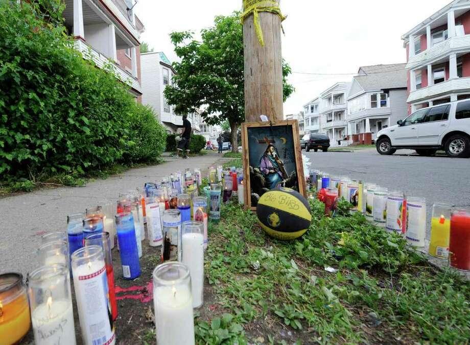 A makeshift memorial for Eddie Stanley was erected on Bridge St. in Schenectady, Monday June 13, 2011, near where Stanley was shot last Sunday.  (Skip Dickstein/ Times Union) Photo: Skip Dickstein