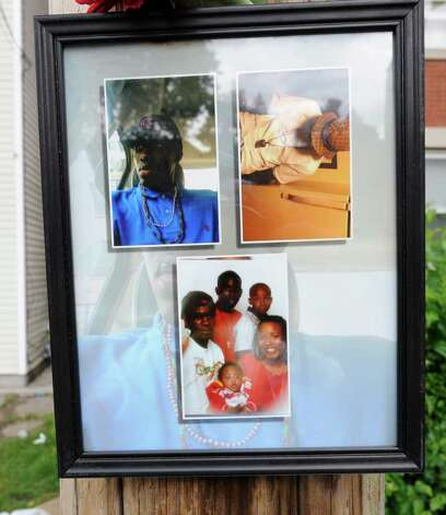 Photographs of Eddie Stanley left at a makeshift memorial on Bridge Street in Schenectady are shown on Monday, June 13, 2011, near where Stanley was fatally shot early Sunday.  (Skip Dickstein/ Times Union) Photo: Skip Dickstein