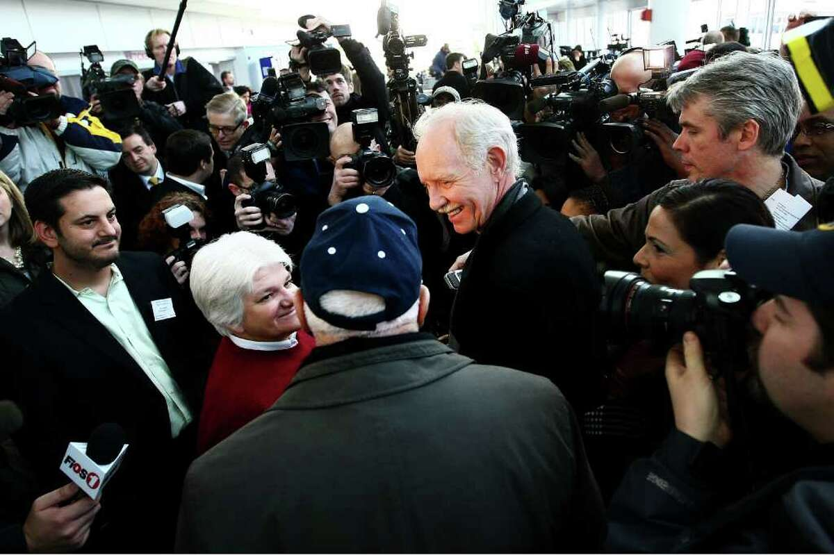 Captain Chesley Sullenberger is mobbed by media as he meets passengers from the US Airways flight 1549 during a reunion to mark the one year anniversary on January 15, 2010 in New York.