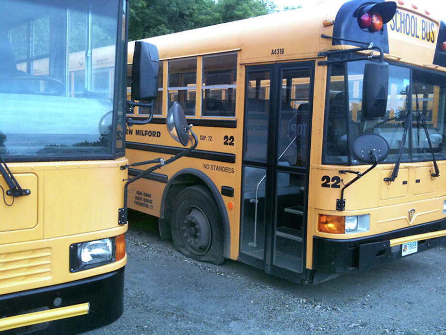 Vandals slashed tires on at least 15 school buses in New Milford, causing a two-hour school delay Monday, June 13, 2011. Photo: Nanci Hutson / The News-Times Contributed