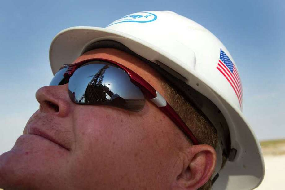 David Darr, Anadarko field superintendent, looks up at the rig drilling on Anadarko's Raybank Well Thursday, June 2, 2011, near the west Texas town of Mentone, about 90 miles west of Midland. Photo: Brett Coomer, Houston Chronicle / © 2011 Houston Chronicle
